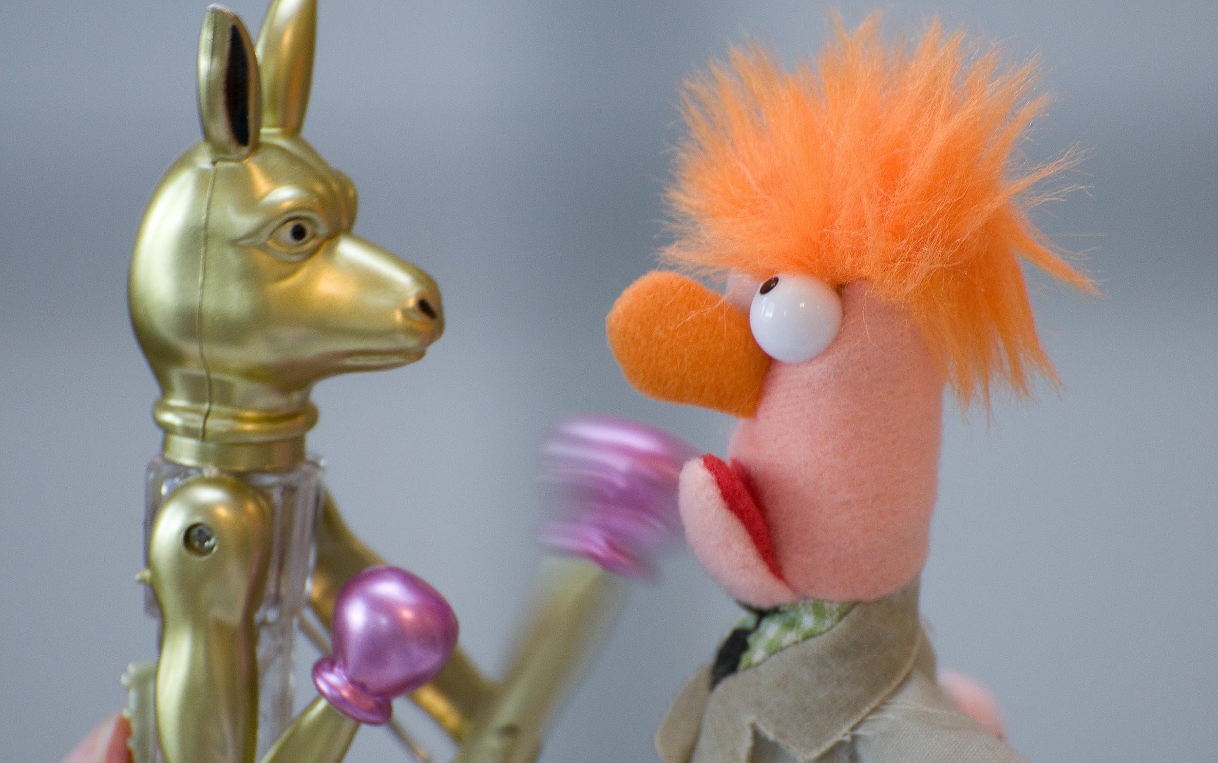 The Muppet Beaker boxes a golden metal kangaroo